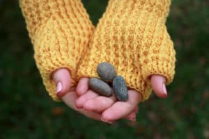 rails-mitts-holding-rocks